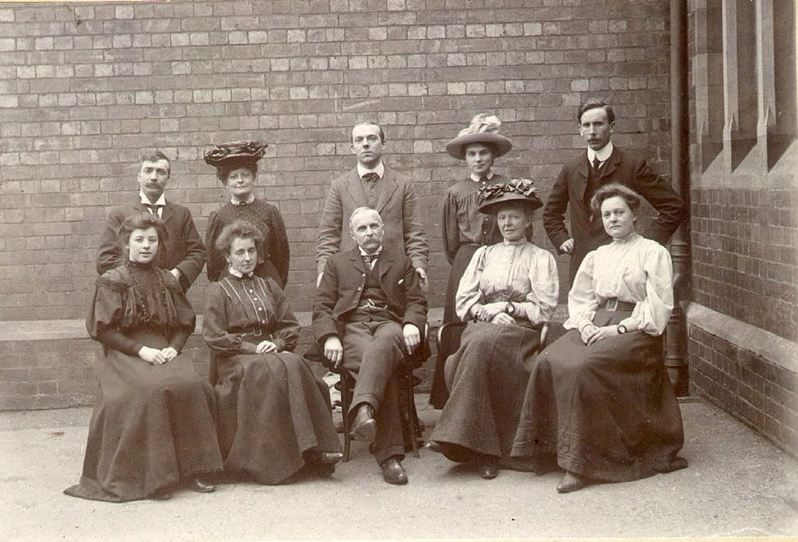 Teachers at Bath Place Infants and Junior schools, Leamington Spa. Back row - left to right - Mr Gaskin, Miss Felton, Mr G. Blower, Miss N. Bickmore, Mr H. Hassel. Front row - Anon. Miss Duffield, Mr Gameson, head of juniors, Mrs Pritchard, head of infants, Miss F. Pritchard.  Circa 1908 |  IMAGE LOCATION: (Leamington Library) PEOPLE IN PHOTO: Pritchard, Mrs, Pritchard, Miss F, Hassell, Mr H, Gaskins, Mr, Gameson, Mr, Felton, Miss, Duffield, Miss, Blower, Mr G, Bickmore, Miss N