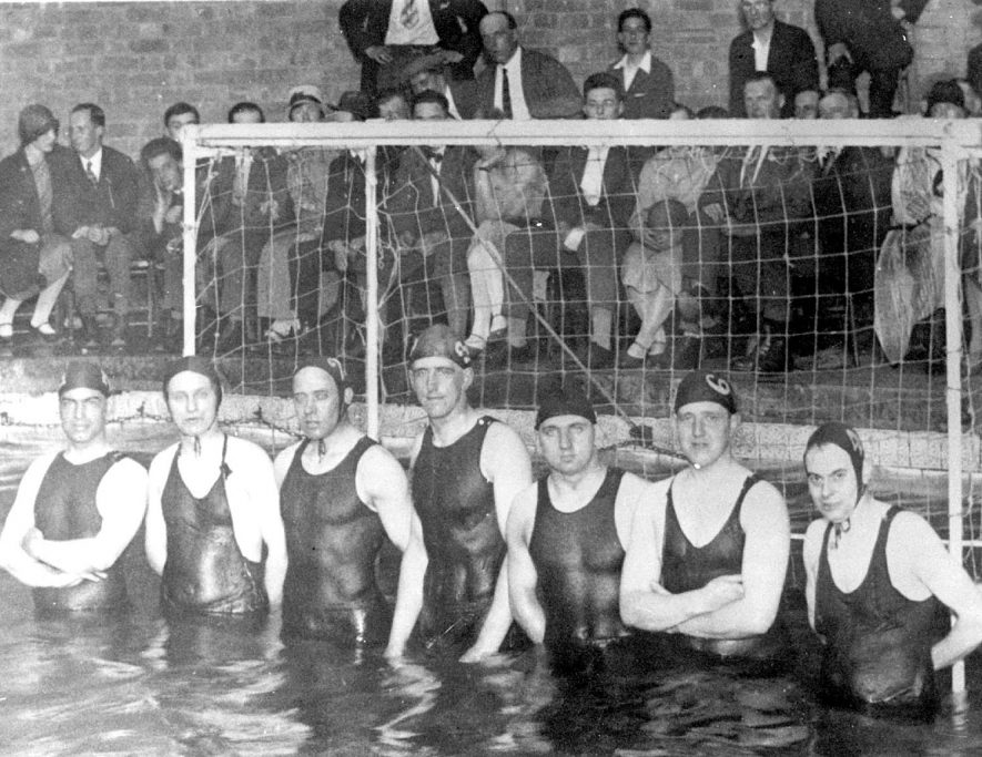 Leamington Spa water polo team just before their game with Weston-super-Mare at the baths in Leamington. Team left to right - Val Clarke, Nobby Cole, Ken Swain, Stan Burte, Ray Baker, Bill Robinson, Frank Treppass (Capt.).  1926 |  IMAGE LOCATION: (Leamington Library) PEOPLE IN PHOTO: Treppass, Frank, Swain, Ken, Robinson, Bill, Cole, Nobby, Clarke, Mr Val, Burte, Stan, Baker, Ray