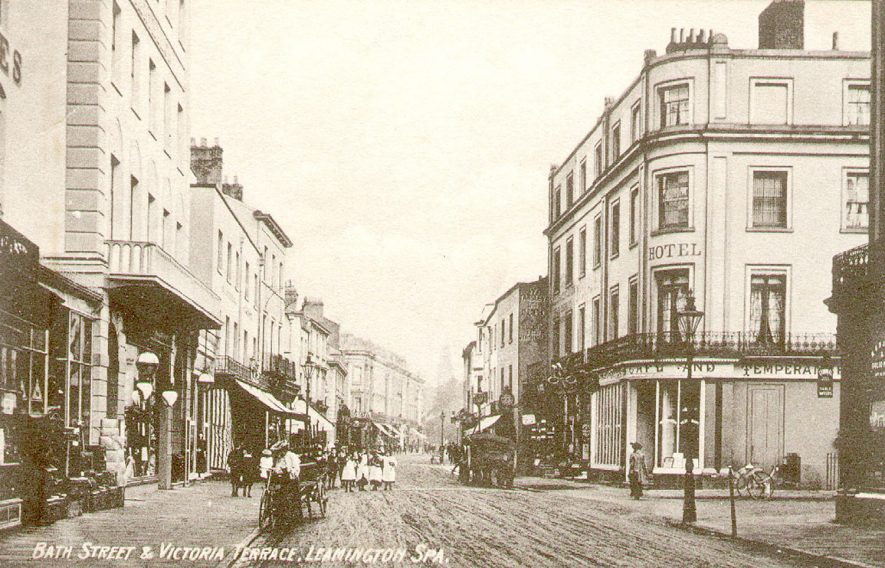 People, carriages and shops in Bath Street, Leamington Spa.  1900s |  IMAGE LOCATION: (Leamington Library)