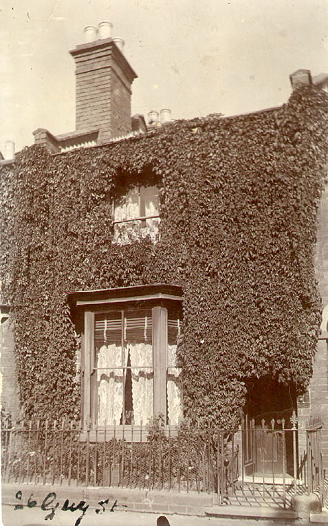 Exterior of ivy clad house, 26 Guy Street, Leamington Spa.  1920s |  IMAGE LOCATION: (Leamington Library)