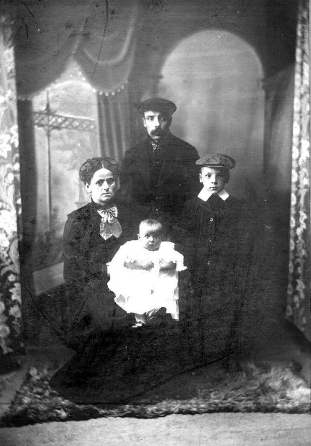 Studio photograph of an unknown collier and his family.  1900s |  IMAGE LOCATION: (Warwickshire County Record Office)