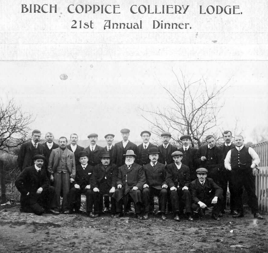 Group photograph of the Birch Coppice Colliery Lodge - 21st Annual Dinner.  Included are William Johnson M.P., C. Jaques, president and J. King, chairman.  1900s |  IMAGE LOCATION: (Warwickshire County Record Office) PEOPLE IN PHOTO: King, J, King as a surname, Johnson, W MP, Johnson as a surname, Jaques, C, Jaques as a surname