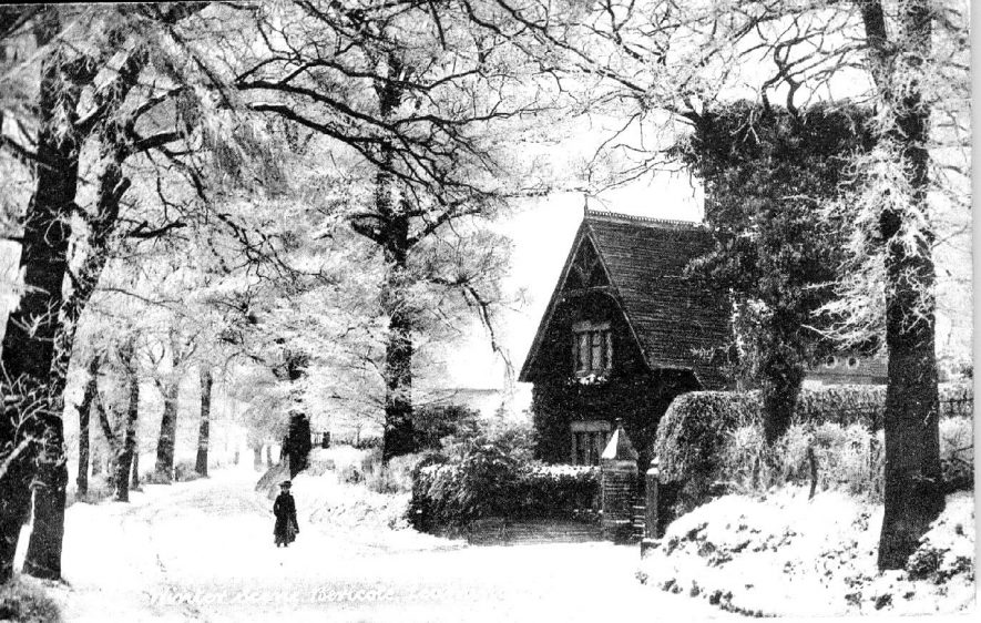 A snow scene showing a country road and the entrance to a house, Bericote Lane, Blackdown, Leamington Spa. 1900s |  IMAGE LOCATION: (Warwickshire County Record Office)