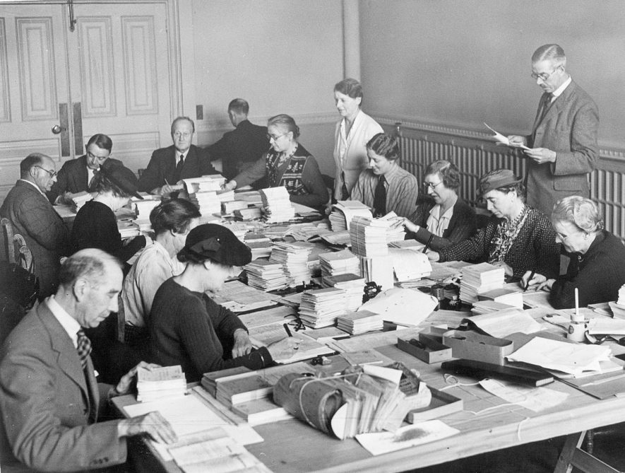 Writing ration cards at the Town Hall, Leamington Spa.  1939 |  IMAGE LOCATION: (Leamington Library)