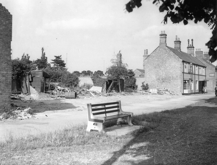 Demolished buildings and Phipps' shop on High Street, Hillmorton.  1961 [It has been pointed out that this building is not a shop but in fact the end view of The Red Lion public house. Phipps is the name of the brewery which owned the pub in those days. A modern bungalow now stands on the demolished area] |  IMAGE LOCATION: (Rugby Library)