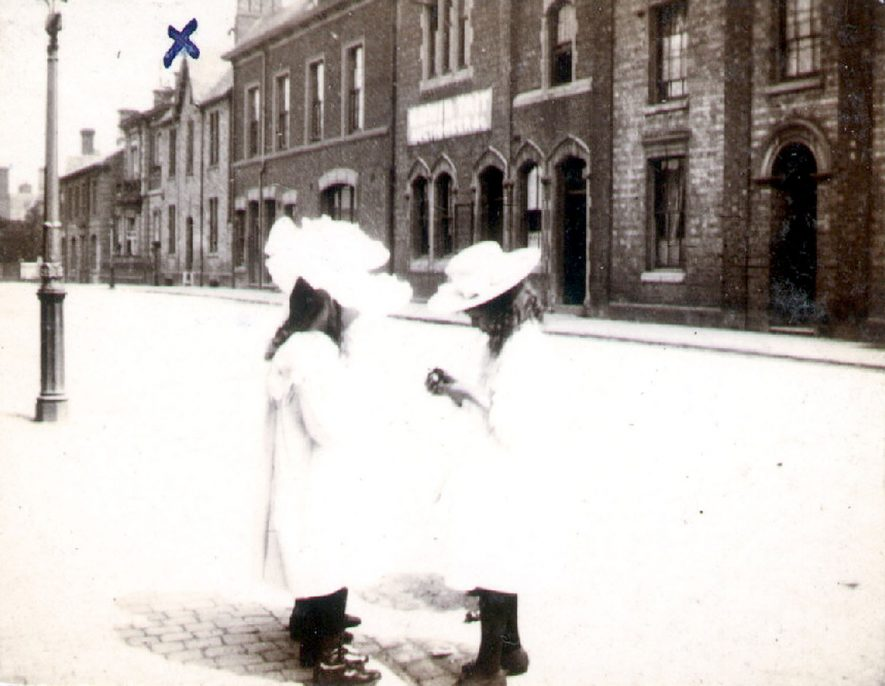 Two little girls deep in conversation,  Albert Street, Rugby.  1901 |  IMAGE LOCATION: (Rugby Library)