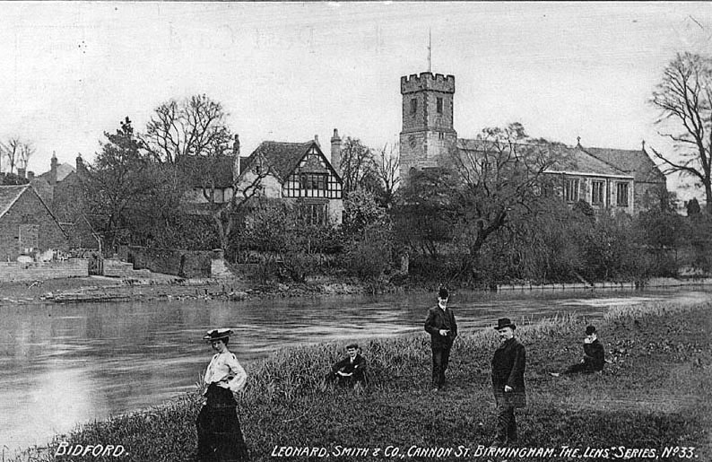 Lady and elderly gentleman with three younger gentlemen on the bank of the River Avon with Bidford on Avon church in the background.  1900 |  IMAGE LOCATION: (Warwickshire County Record Office)