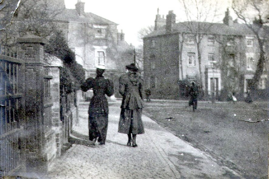 Two ladies walking along Bilton Road, Rugby.  1899 |  IMAGE LOCATION: (Rugby Library)