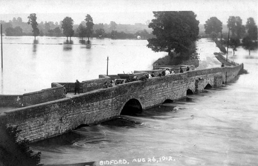 View of the bridge, flooded River Avon and surrounding area. Bidford on Avon, 1912 |  IMAGE LOCATION: (Warwickshire County Record Office)
