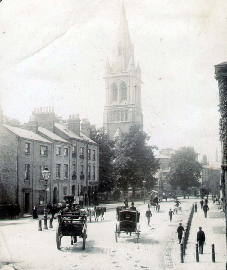 Church Street, Rugby.  View of St Andrew's Church, terraced housing, horsedrawn vehicles and pedestrians.  1900 |  IMAGE LOCATION: (Rugby Library)