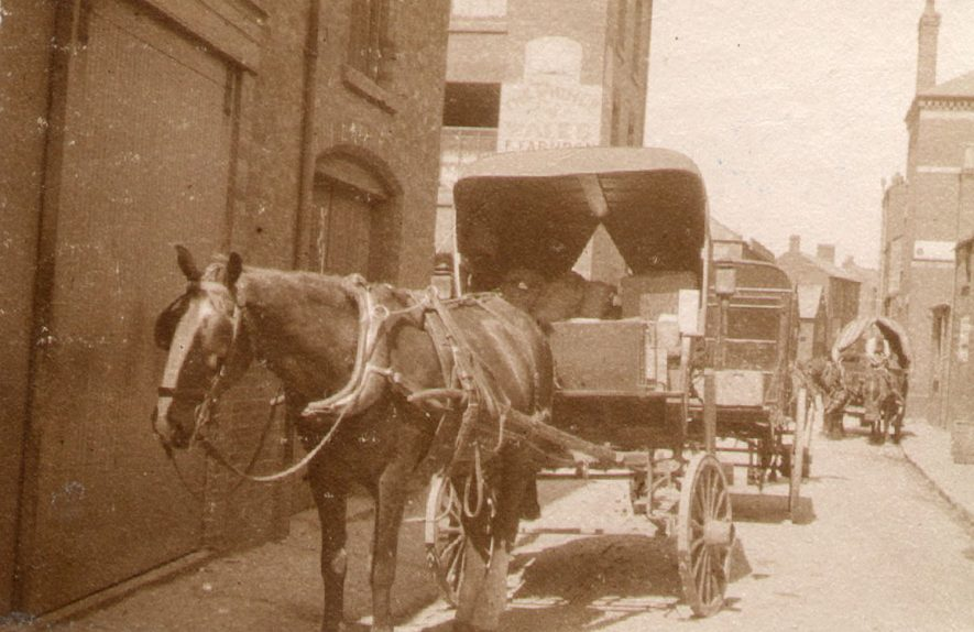 Drury Lane, showing horse drawn delivery vans, Rugby.  1900 |  IMAGE LOCATION: (Rugby Library)
