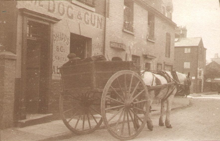 A horse and cart waits outside