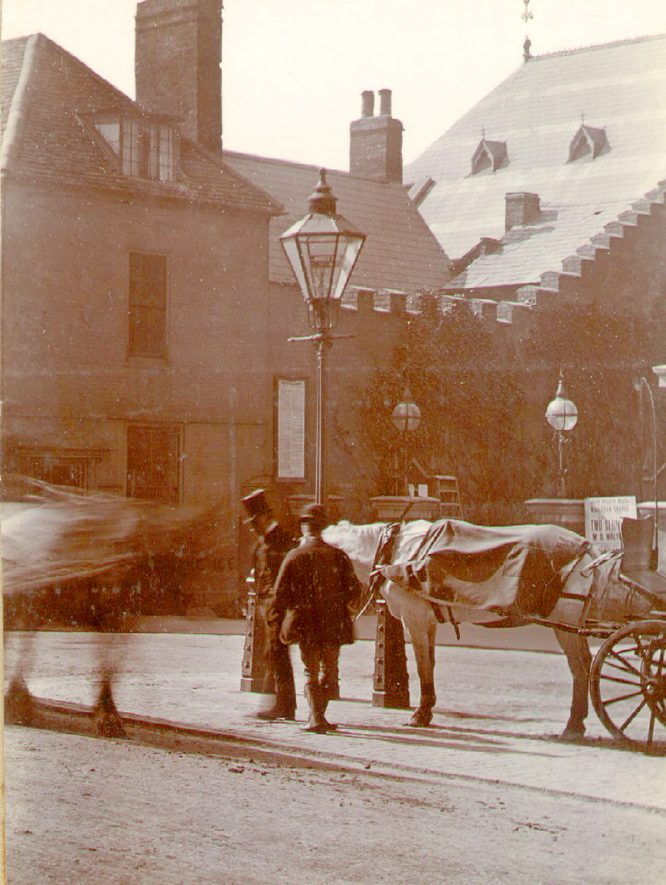 Photo taken in the Market Place between 1878 and 1890, showing the entrance to the Wesleyan chapel, which was built in 1869. |  IMAGE LOCATION: (Rugby Library)