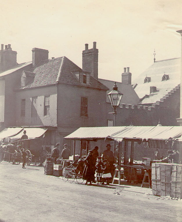 The Market Place at Rugby, showing the stalls.  1880s |  IMAGE LOCATION: (Rugby Library)
