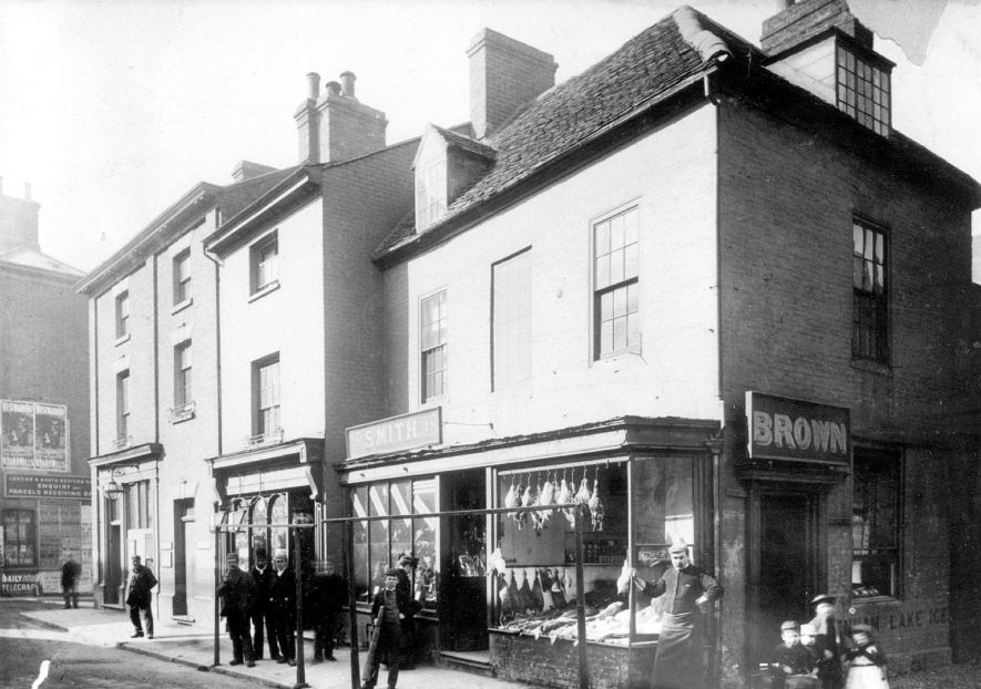 W. Brown's at no 16, Market Place, and W. Smith's at No 18.  The Post Office is on the corner of Chapel Street.  1880s |  IMAGE LOCATION: (Rugby Library)