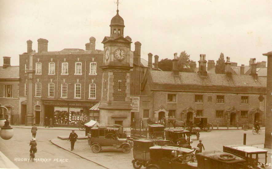 Market Place with the clock tower.  1910s |  IMAGE LOCATION: (Rugby Library)