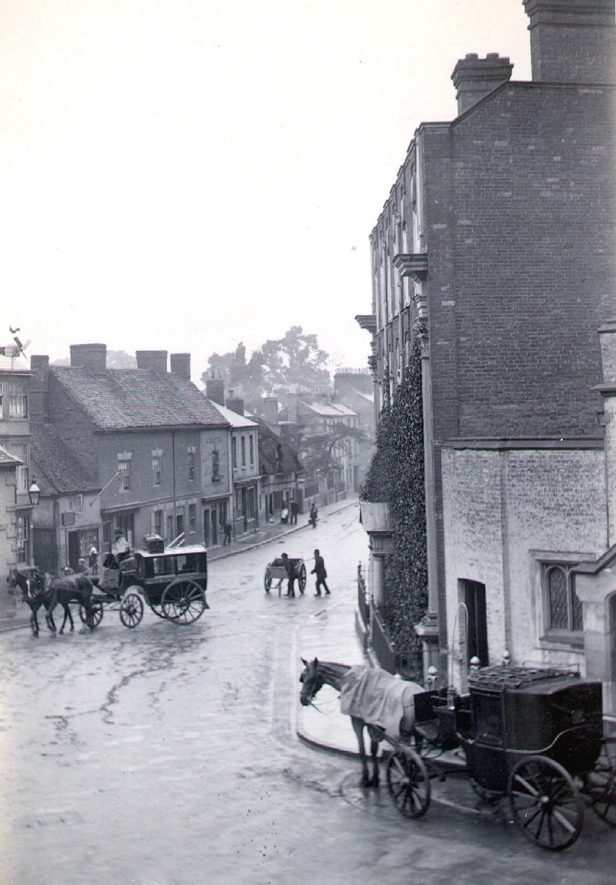 North Street, Rugby showing horse cab and a carriage.  1895