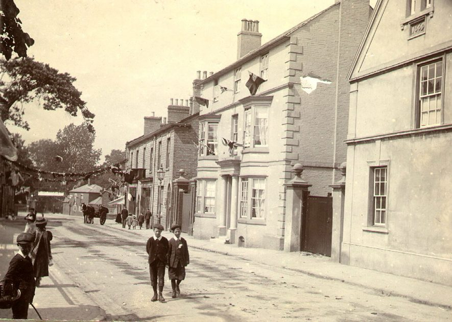 North Street showing the house named Bennfield, home of the Benn family, decorated for Queen Victoria's Diamond Jubilee, Rugby.  1897    IMAGE LOCATION: (Rugby Library)