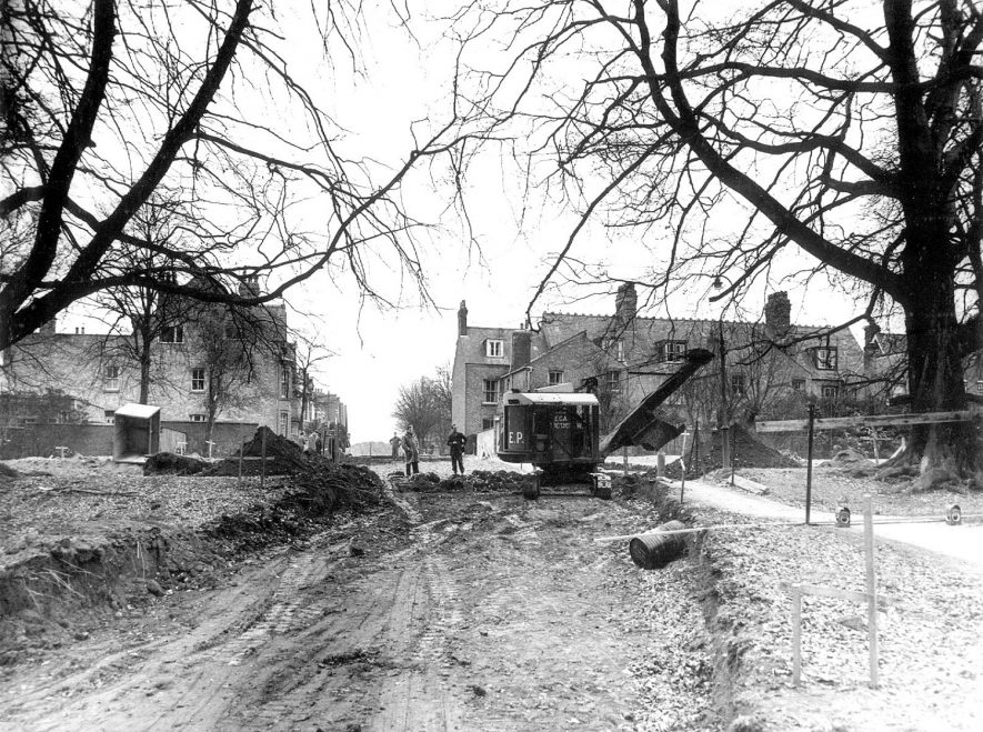 A road being driven through the Chestnut Field, in March 1959, to help improve traffic conditions in the centre of Rugby.  The road links Regent Place and Park Road and gives access to Corporation Street, the bypass which was opened in 1958.  1959 |  IMAGE LOCATION: (Rugby Library)