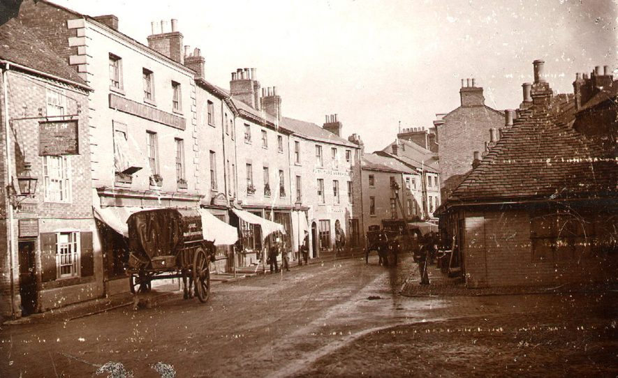 The public house on the extreme left was called the 'Hen and Chickens and demolished shortly after the photograph was taken.  Warwick House, next to it goes back to at least 1709 when the deeds describe it as a 'Coopers and Buttery', it was demolished in 1959 and rebuilt.  1865 |  IMAGE LOCATION: (Rugby Library)