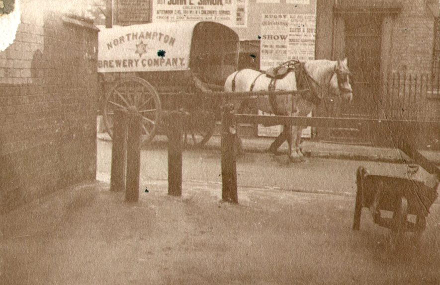 The Spinney, which no longer seems to exist, showing a brewery cart and horse, Rugby.  1914 |  IMAGE LOCATION: (Nuneaton Library)