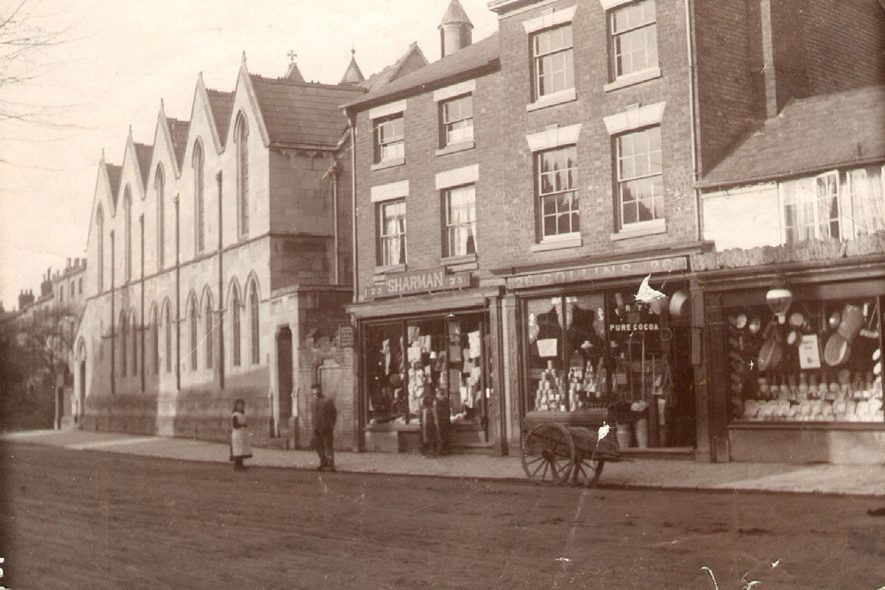 Warwick Street, Rugby.  Showing shops and St Matthew's Church.  1900 |  IMAGE LOCATION: (Rugby Library)