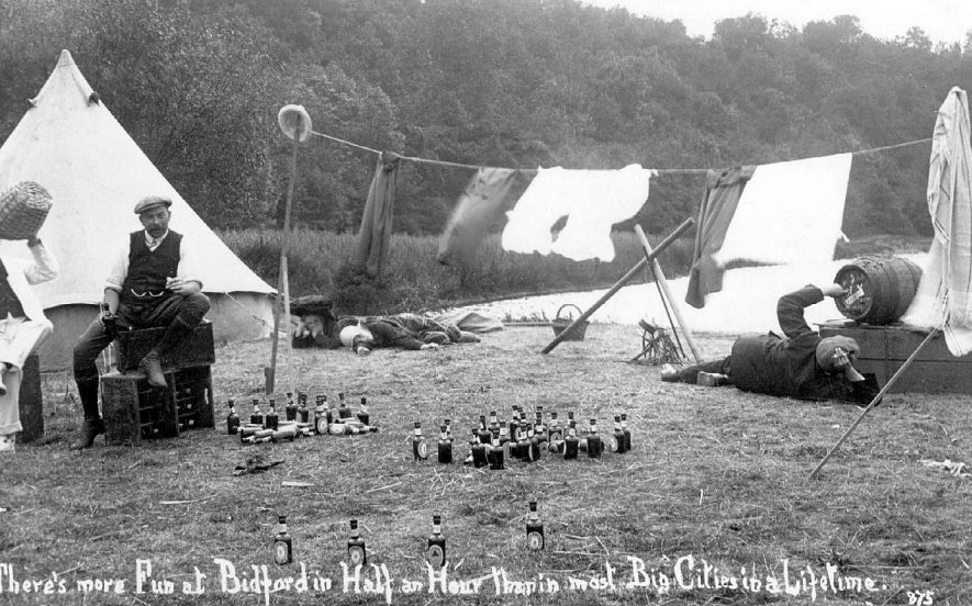 Humorous photograph of four men camping by the riverside with copious supplies of beer. 1914. Bidford has always had a certain reputation: