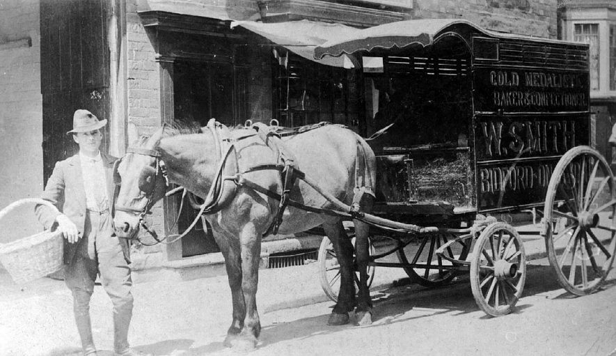 Mr. W. Smith,  baker, of  Bidford on Avon with his horse driven delivery van.  1916 |  IMAGE LOCATION: (Warwickshire County Record Office) PEOPLE IN PHOTO: Smith, Mr W, Smith as a surname