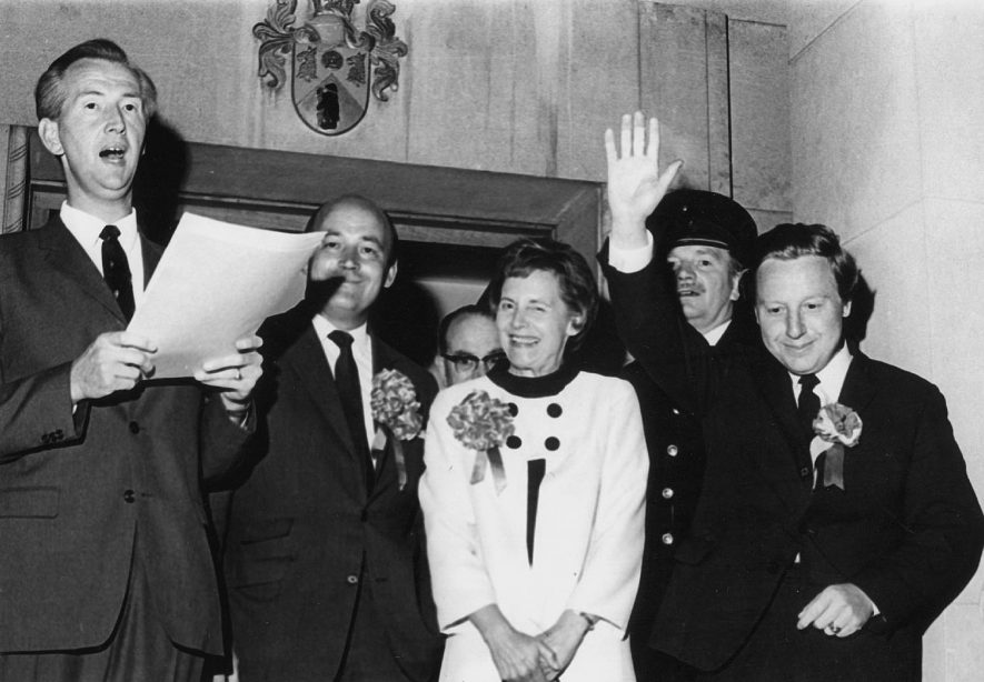 Rugby Town Clerk announcing the General Election results of 1970.  Photograph supplied by kind permission of the Rugby Advertiser. |  IMAGE LOCATION: (Rugby Library) PEOPLE IN PHOTO: Price, Williuam, Price as a surname, Griffiths, Mrs, Griffiths, Huw, Griffiths as a surname, Brown as a surname, Brown, Chief Supt. Percy, Ashworth, I E, Ashworth as a surnaame