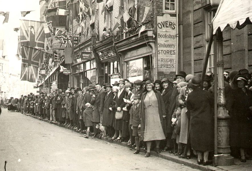 Rugby Charter Day showing crowds in High Street awaiting the procession.  1932  Photograph supplied by kind permission of the Rugby Advertiser. |  IMAGE LOCATION: (Rugby Library)