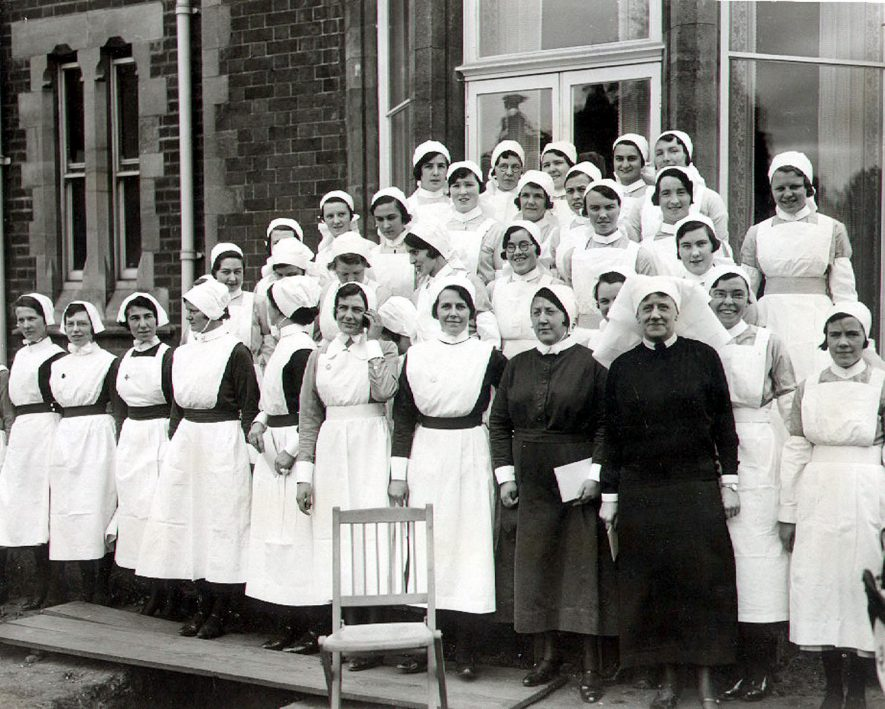 Matron and nursing staff of St Cross Hospital at the laying of the foundation stone of the nurses home by the Lord Mayor of London, Rugby.  1934