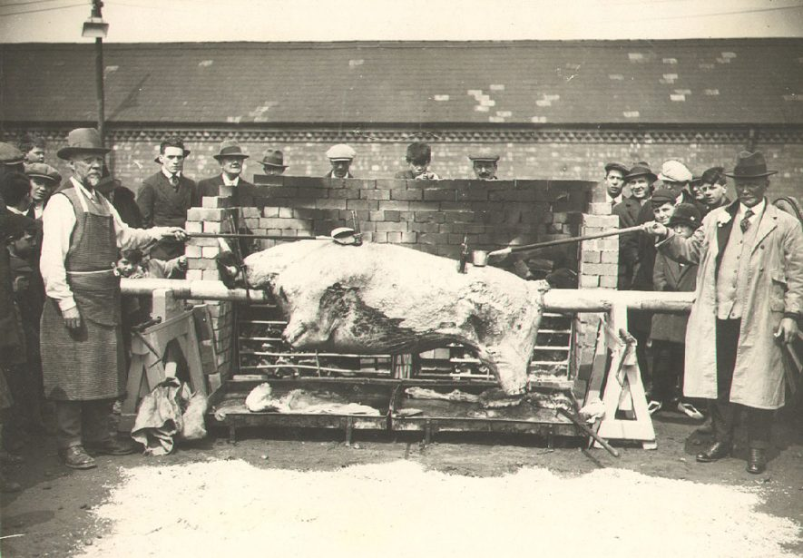 Ox roast at The Fairground in Railway Terrace on the occasion of the Duchess of York's visit, Rugby.  1929