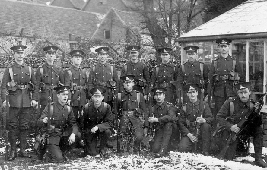 Group of soldiers, from the 3rd Birmingham Battalion, 16th Royal Warwickshire Regiment, on the lawn of the Holly Bush.  April 1915 |  IMAGE LOCATION: (Warwickshire County Record Office)