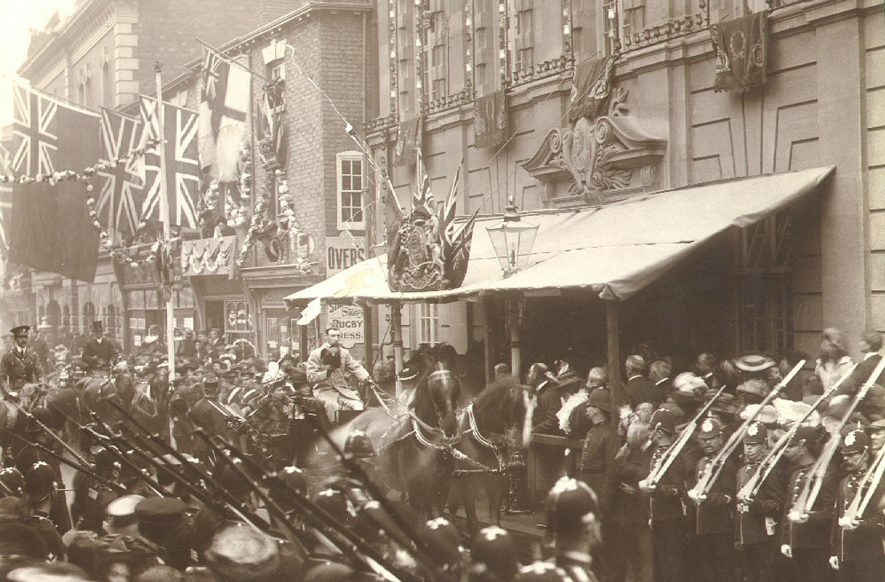 The address of welcome being read to H.R.H. Princess Henry of Battenberg in High Street, Rugby.  1907 |  IMAGE LOCATION: (Rugby Library)
