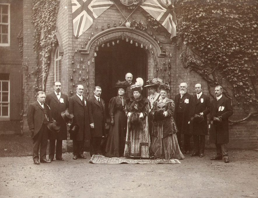 Group outside St Cross Hospital during a visit by H.R.H Princess Henry of Battenberg to open the new children's  ward.  From left to right are J T Smith, G W Walton, W H Linnell, Mr Arthur James, Mrs Arthur James, Canon Baillie, Princess Henry of Battenberg, Hon Mrs Baillie, Marchioness of Hertford, Revd. Charles Elsee, Mr C F Harris and W D Muriel.  Rugby.  1907    IMAGE LOCATION: (Rugby Library) PEOPLE IN PHOTO: Walton, G W, Walton as a surname, Smith, J, Smith as a surname, Muriel as a surname, Linnell, W H, Linnell as a surname, James, Mrs W, James as a surname, Hertford, The Marchioness of, Harris, C F, Harris as a surname, Elsee, Revd C, Elsee as a surname, Battenberg, H R H The Princess Henry of, Baillie, The Hon Mrs, Baillie, Revd Canon, Baillie as a surname