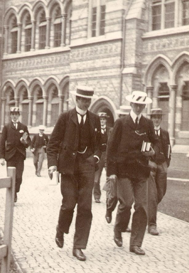 Rugby school boys in the Quadrangle outside school building.  Initials R.G.F. for boy on left, J.N.G for boy on right, A..R.W. for boy between them. Donated by Mrs R Hosking.  1890s |  IMAGE LOCATION: (Rugby Library)