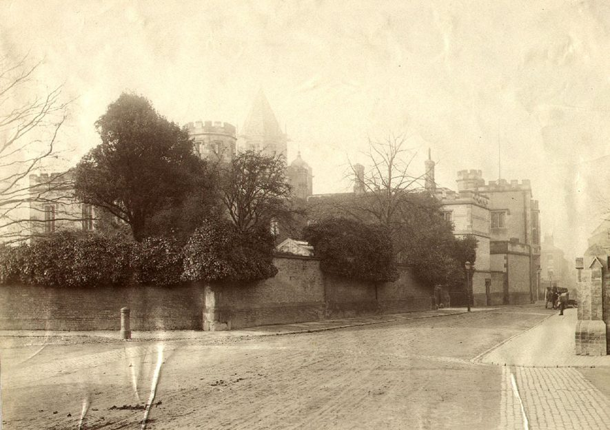 Pre 1873 photograph showing street with Rugby School buildings on left, Rugby.  Donated by Mrs. B. Batt.  1860-70s |  IMAGE LOCATION: (Rugby Library)