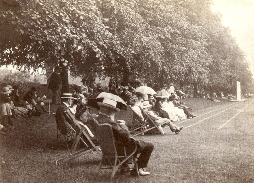 Rugby School Speech Day 27 June 1908. Spectators sitting under the lime trees by the sports track. Photograph donated by Mrs R. Hoskins.  1908 |  IMAGE LOCATION: (Rugby Library)