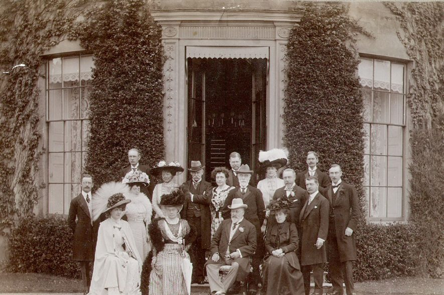 House  party at Coton House, the home of Mr and Mrs Arthur James, held on 3rd July 1909, after King Edward VII had opened the Temple Speech Room at Rugby School.  Back Row: Colonel Streatfeild; Lord Leicester; Lady Norreys; The Earl of Durham, K.G.  Middle Row: Mr John Baird C.M.G.;  Mrs W. James; Lady Savile; The Duke of Richmond and Gordon, K.G.; Mrs Arthur James, Mr Whitelaw Reid; Mr J. Lowther; Mr Arthur James;  Front Row:  Mrs G. Keppel; Mrs Whitelaw Reid; H.M. King Edward VII; Lady Leicester |  IMAGE LOCATION: (Rugby Library) PEOPLE IN PHOTO: Streatfeild as a surname, Savile, Lady, Richmond and Gordon, K G Duke of, Reid, Mrs Whitelaw, Reid, Mr Whitelaw, Reid as a surname, Norreys, Lady, Lowther, Mr J, Lowther as a surname, Leicester, Lord, Leicester, Lady, Keppel, Mrs G, Keppel as a surname, James, Mrs Arthur, James, Mr Arthur, James as a surname, Hamilton of Dalzell,  Lord, Edward VII, Durham, Earl of, Baird, Major Sir John, Baird as a surname