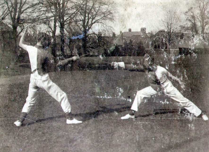 Fencing contest with M Dewar on the left at Rugby Sports.  1904 |  IMAGE LOCATION: (Rugby Library) PEOPLE IN PHOTO: Dewar as a surname, Dewar, M B H
