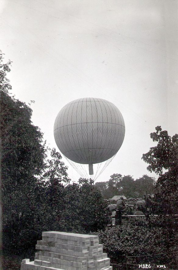 Descent of balloon at Rugby Hospital carnival, in which Captain Harry Spencer was killed when he fell from the roof of Rev. J.M. Hardwick's boarding house, on which the balloon landed. The balloon was piloted by his son, Percival. See Rugby Advertiser - 9th September 1928. |  IMAGE LOCATION: (Rugby Library)