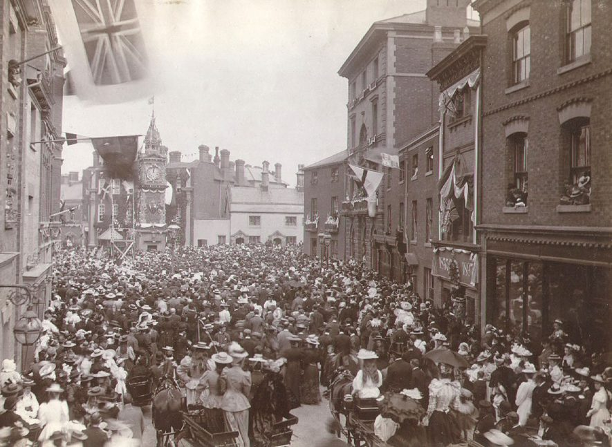 A large crowd of people in Market Place, Rugby, during Queen Victoria's Diamond Jubilee celebrations.  June 22nd 1897 |  IMAGE LOCATION: (Rugby Library)