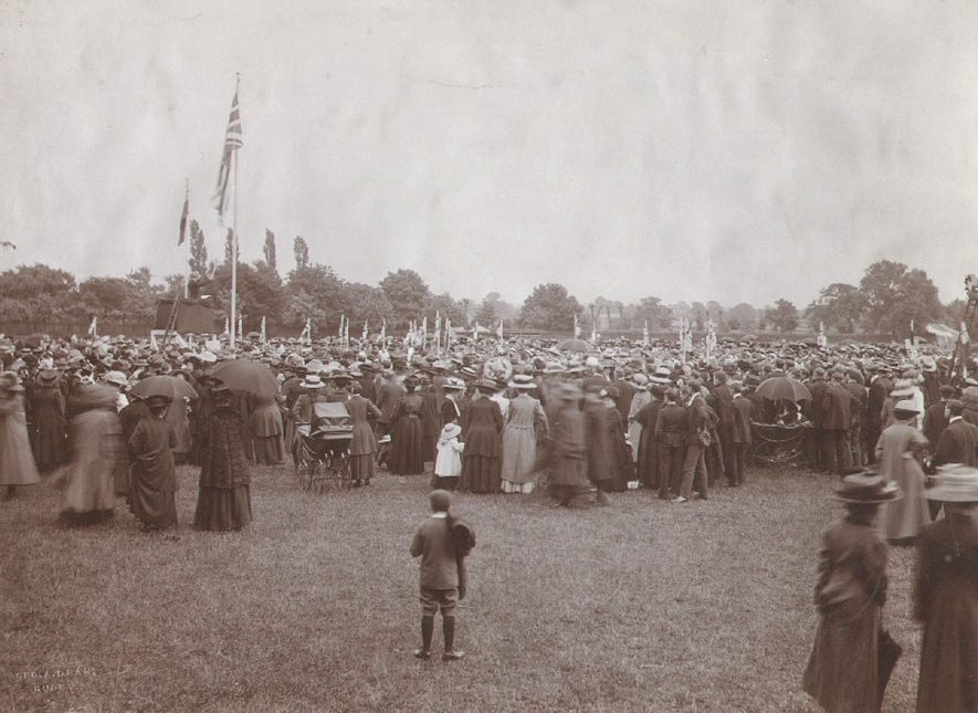 Large crowd of people on the recreation ground at Rugby, watching the hoisting of a flag presented by the children of Rugby, Australia, to commemorate the coronation of King George V.  June 23rd 1911 |  IMAGE LOCATION: (Rugby Library)