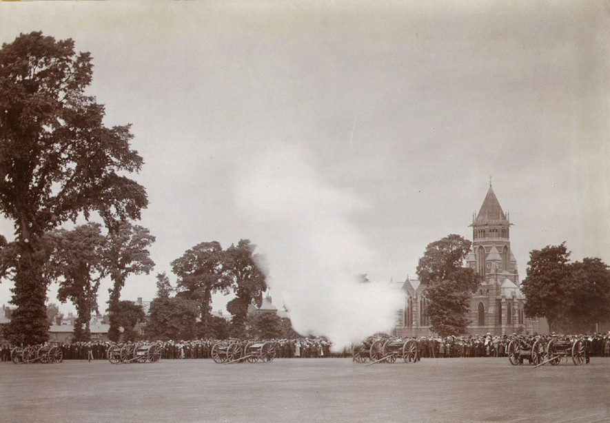 Crowd watching the firing of the Royal Salute by the Howitzer Battery in Rugby School Close during the coronation celebrations of King George V.  June 22nd 1922 |  IMAGE LOCATION: (Rugby Library)