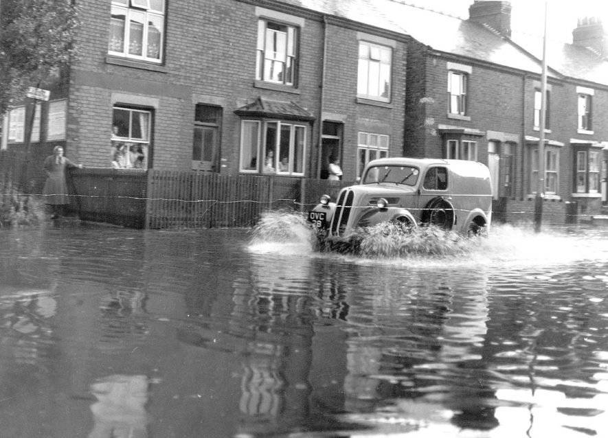 Temporary flooding in Lawford Road, New Bilton, Rugby. July 3rd 1958Photograph supplied by kind permission of the Rugby Advertiser.    IMAGE LOCATION: (Rugby Library)
