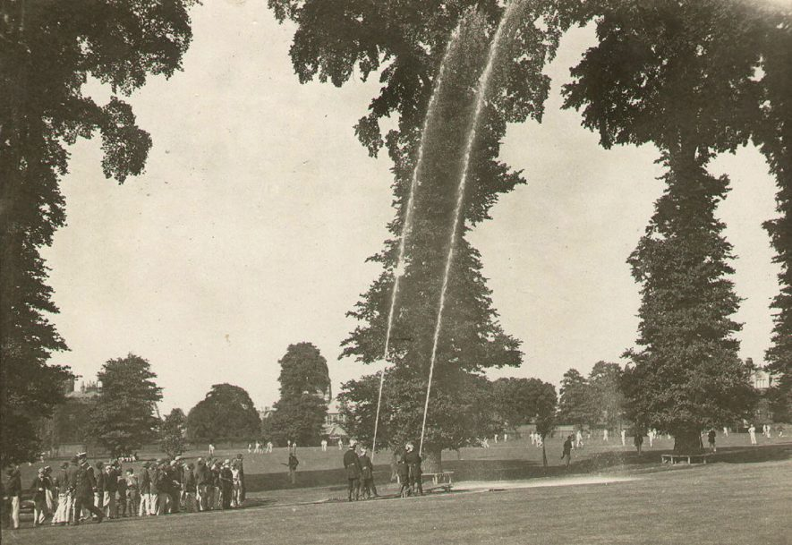 The Volunteer Fire Brigade testing the new steam fire engine in Rugby School Close. The photograph shows the first jets 7/8th of an inch in diameter.  See Rugby Advertiser - July 4th 1914, p.5.  1914 |  IMAGE LOCATION: (Rugby Library)