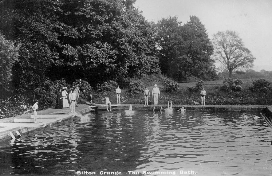 The swimming bath at Bilton Grange with boys swimming and adult onlookers.  1900s |  IMAGE LOCATION: (Warwickshire County Record Office)
