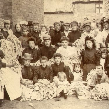 Rugby.  Group of men, women and children