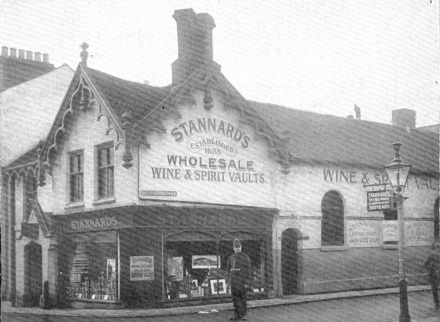 Stannard's wholesale wine & spirit vaults in Sheep Street, Rugby (formerly The Red Lion Inn). This photograph was taken before demolition for road widening in 1926. See Rugby Advertiser April 2nd 1926.  1920s |  IMAGE LOCATION: (Rugby Library)