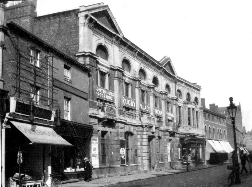 The Rugby Palace Cinema on upper floor of Town hall in High Street. First appears as Vint's Palace Cinema in Rugby Directory, 1913. Building burned down on 30th January 1921.  1920  [The Town Hall had since start of 20th Century been he Benn Building further down the street on the opposite side. Also, though the building caught fire it certainly wasn't burnt down, after repairs it opened as Woolworths in 1923.] |  IMAGE LOCATION: (Rugby Library)